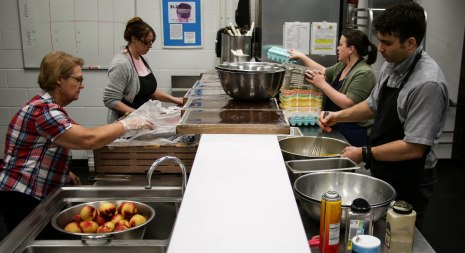 Volunteers at Blood N' Fire prepare food for the community meal in Muncie, IN on April 14. The organization has a community meal every Saturday. Photo by Rebecca Slezak