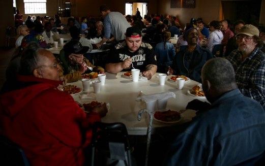Community members of Muncie eat a meal hosted by Blood N' Fire in Muncie, IN on April 14. Volunteers prepare 150 meals for muncie residents. Photo by Rebecca Slezak