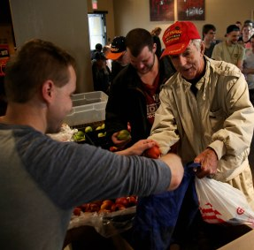 Volunteers pass out produce for Muncie community members at the Blood N' Fire community meal on April 14 in Muncie, IN. The organization has a community meal every Saturday. Photo by Rebecca Slezak
