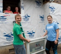 Ball State exercise science students Katie Smith (top left), Kiersten Brannon (top right), Tanner Pearson (bottom left) and Sarah Maxson (bottom right) prepare to install a window at 1616 South Elm Street in Muncie, Ind. on April 14, 2018. These students are volunteering with Habitat for Humanity to restore this home for a family in need. Photo by: Mallory Huxford