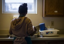 In the lower level of Avondale United Methodist Church, off of 10th and Sampson St in Muncie, Ind., Ball State Urban Planning Graduate Student Varu Musumuri, washes dishes while her classmates and other volunteers prepare the weekly Thursday night commune dinner for the community. Grace Hollars, NPPA