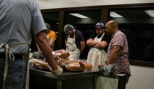 The volunteers at Muncie Mission Ministries pray before preparing lunch for the men in their recovery program on April 14 in Muncie, IN. Muncie Mission Ministries is a faith-based organization that helps men in recovery. Photo by Rebecca Slezak