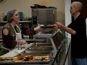 Volunteers serve food on April 14 in Muncie, IN for the men in their recovery program at Muncie Mission Ministries. The organization has a facility and program for men who are homeless or in need. Photo by Rebecca Slezak