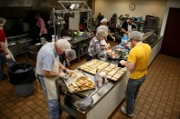 Muncie Mission Ministries' volunteers prepare food on April 14 in Muncie, IN for the men in their recovery program. Munie Mission Ministries has served the homeless and those in need in Delaware County for more than 80 years. Photo by Rebecca Slezak