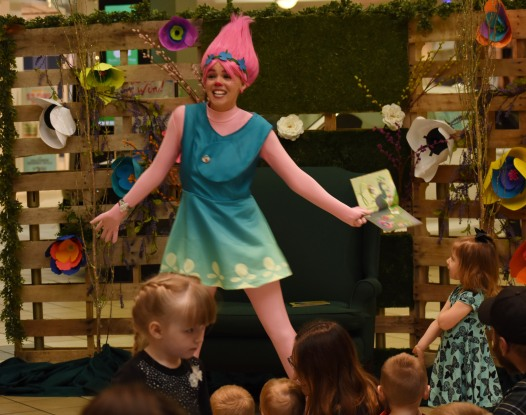 Children from ages 3 and up join Princess Troll for story time at the Muncie Mall on April 14. Photo by Harrison Raft.