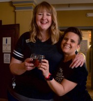 Olivia Willard (left) and Morgan Boone (right) help facilitate a smooth running of Cornerstone Center for the Arts' annual Brewfest on April 13, 2019 in Muncie, Ind. Brewfest is a fundraiser in which breweries all across Indiana celebrate their love of beer and invite the community to taste their concotions. All of the proceeds from ticket sales go toward Cornerstone to further their mission of giving arts education to Muncie.