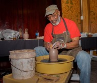 Eugene Boyd, a ceramics instuctor at Cornerstone Center for the Arts demonstrates how to craft a clay pot on the potters wheel at their annual Brewfest on April 13, 2019.