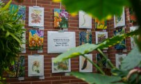 "Also featured in the Rinard Orchid Greenhouse is artwork by Ball State art students and Muncie community artists. The art, ""Inspired by Orchids,"" will be available for guests to see until the end of April. Breanna Daugherty 