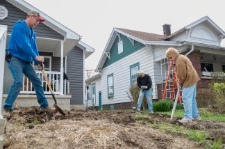 A group of volunteers from Riverside United Methodist Church assist Habitat For Humanity in landscaping and yard clean up of a newly renovated home at 1804 South Jefferson St. on Saturday, April 13, 2019 in Muncie, IN.