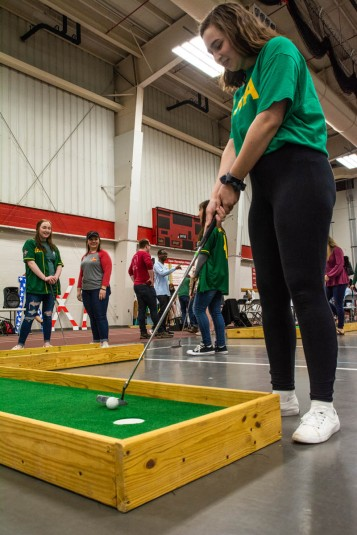 Supporters enjoy a round off putt-putt during Ball State's Lambda Chi Alpha annual philanthropy event, Lambda Open, on Sunday, April 7, 2019, in the Field & Sports Complex. All money raised during the event is donated to Second Harvest Food Bank.