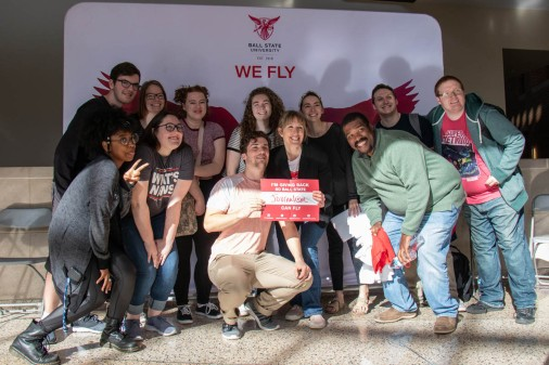 "Ball State students and faculty pose in front of a ""we fly"" banner in the David Letterman Building April 9, 2019 during One Ball State Day. One Day Ball State is a fundraising event for the Ball State Foundation that provides scholarships for students at the university. Eric Pritchett, DN"