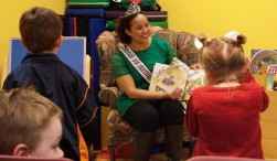 Ball State student Justice Amick reads books to children at the Kennedy Library in Munice, Indiana on April 12,2019.