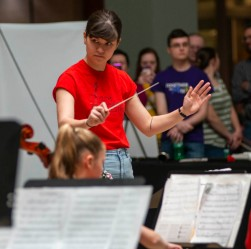 A Youth Symphony Orchestra of East Central Indiana member conducts the orchestra during the April 13 concert in the Muncie Mall. Breanna Daugherty | SFG