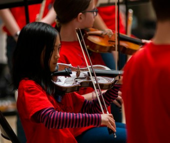 A Youth Symphony Orchestra of East Central Indiana member plays the violin at the Muncie Outreach concert on April 13 at the Muncie Mall. The mission of organization is to provide weekly musical experiences and education for young musicians through its programs and activities. Breanna Daugherty | SFG