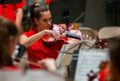 A Youth Symphony Orchestra of East Central Indiana member plays the violin at the Muncie Outreach concert on April 13 at the Muncie Mall. Breanna Daugherty | SFG