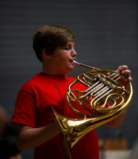 A Youth Symphony Orchestra of East Central Indiana member plays the French horn at the Muncie Outreach concert on April 13 at the Muncie Mall. Members of the orchestra learn to perform orchestral masterworks, both traditional and contemporary. Breanna Daugherty | SFG