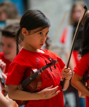 One of Youth Symphony Orchestra of East Central Indiana members waits for the final song to begin of the Muncie Outreach concert on April 13 at the Muncie Mall. The orchestra is geared toward students of all ages. Breanna Daugherty | SFG
