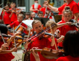 Members of the Youth Symphony Orchestra of East Central Indiana perform the final song together on April 13 to conclude the Muncie Outreach concert at the Muncie Mall. Breanna Daugherty | SFG