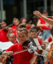 Members of the Youth Symphony Orchestra of East Central Indiana perform the final song together on April 13 to conclude the Muncie Outreach concert at the Muncie Mall. The orchestra is open to advanced players of strings, brass, woodwind, percussion, and harp instruments. Breanna Daugherty | SFG